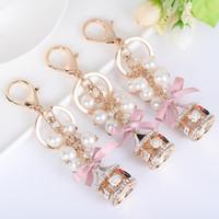 Catene Carousel Perline chiave dell'automobile per gioielli delle donne ragazze Lady Ciondolo strass fascino del sacchetto chiave del metallo del regalo di Keychain dell'anello di modo Holder Portachiavi