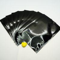 200pcs / lot 7x10cm calore sigillabile nero di alluminio piatto Bag-alluminato placcatura alimenti Imballaggio Pacchetto Bustina, commercio all'ingrosso di plastica colorata Sack