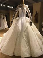 Dubai Arabo Lusso 2019 Abiti da sposa con lacci sul retro Sexy bling con perline di pizzo Applique Collo alto Maniche lunghe Abito da ballo Cappella Abiti da sposa