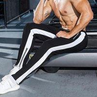 الرياضة رياضية للياقة البدنية عداء ببطء بنطال رياضة الرجال GYM سروال الربيع أسود أبيض مقلم طويل سروال رصاص زيبر مصمم