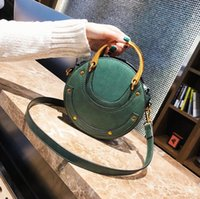 50pcs 2019 Cross body Bag Women pu rivet Saddle Round Shape ...