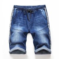 2 Estilos para hombre Pantalones cortos de verano Denim Jeans Diseño bolsillo lateral elástico rayas Jeans para hombre Calle manera ocasional