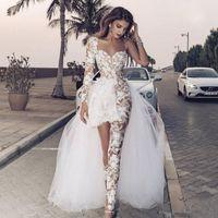 Jumpsuit de bodas de encaje sexy con tren desmontable 2020 ilusión manga larga peplum cuello bohemio playa novia vestido de novia con pantalón