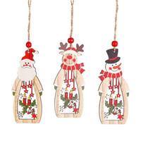 Decoración del árbol colgante de madera hueco de Santa muñeco de nieve reno Carve colgante Adornos de Navidad favores de la celebración de días JK1910