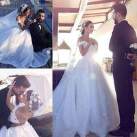 Dernière robe de billes Robes de Wedding Robe d'épaule Appliques Floral Tulle Organza Chapelle Backless Chapelle Bridal Bridal Robes de mariée Dubaï