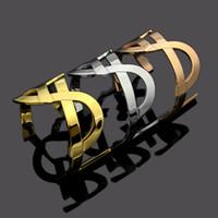 أعلى جودة والعلامة التجارية النحاس المواد الشرير افتتح جوفاء أساور تصميم الكفة سوار أزرار أكمام إرسال نساء وأم هدية