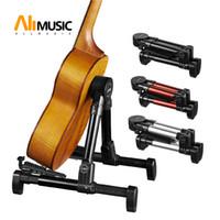 Pieghevole pieghevole Una cornice strumento stand per chitarra, basso, violino, Ukulele, banjo, mandolino