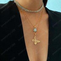 レトロなスタイルのマルチレベルのゴールドの明るいフルラインストーンの花蝶の形のペンダントネックレスファッションチャームジュエリー女性のための宝石
