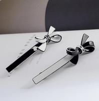 10x3cm noir et blanc archet acrylique pince à cheveux pince pince pince pince wig dadys collection bijoux cadeau d'anniversaire 4 pcs / lot