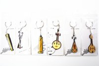 6pcs Niko gomma Classical Chinese Nazione strumento musicale Ruan / Guzheng Pipa / GuqinMandolin Portachiavi / portachiavi