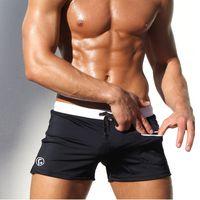 Купальники Мужчины Sexy плавках Sunga Купальник сплошной цвет Карманный Mens Swim Wear Трусы Пляж шорты