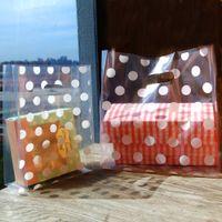 أكياس البولكا نقطة بلاستيكية بيضاء ، وأكياس التسوق البلاستيكية ، وتجارة التجزئة حزب الإحسان حقيبة هدية حقيبة 50pcs / lot