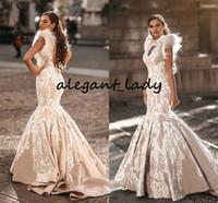 Robe de mariée de plume de plumes en dentelle 2020 Champagne arabe haut col de la porte-mole de serrure ouverte dos dinde robe de mariée Dubaï Robes de mariée