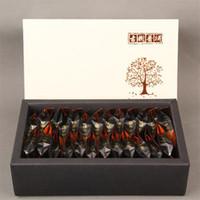 125g chinesischen Yunnan Alter Baum Reife Puer Mini Loser Tee Gekochte Puerh Schwarzer Tee Gesunde grüne Nahrung Geschenk-Verpackung