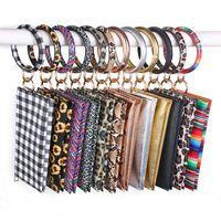 PU sacs porte-clefs en cuir O Bracelet Porte-clés Accrochez-monnaie Sac de téléphone Tassel Wristlet Keychain fermeture éclair sacs FFA4183