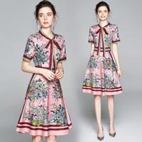 Nouveau style d'été imprimé floral piste vintage noeud papillon cou à manches courtes Bouton avant Femme Mesdames Party Casual A-Line Robe mi-longue