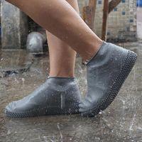 1 par reutilizable de látex impermeable de la lluvia Zapatos Cubiertas resistente al deslizamiento de goma cargador de lluvia Overshoes S / M / L Zapatos Accesorios