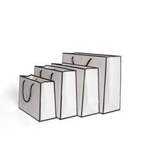 Regalos Tarjeta del blanco de embalaje de papel kraft bolsa de ropa bolsas de moda bolso de las compras de almacenamiento Publicidad ambientales personalizado 1 86GR B2