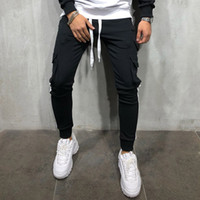basculador pantalones de chándal grises de los hombres de ropa deportiva pantalon tijeras impresión de la mano gimnasio de fitness pantalones lápiz hombres de la moda