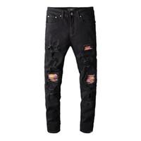 Designer Hommes Jeans Distressed Ripped Biker Slim Fit Motard Denim pour les hommes Hip Hop Rose taches noires Skinny Jeans