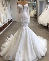 2019 Robe sexy en dentelle blanche de mariée sirène vintage Bohême plage Appliqued à manches longues robe de mariée avec des plumes taille plus Fait sur mesure