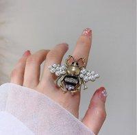 Europa e América exageraram personalidade retro rede de pérola vermelha abelha grande anel de moda feminino temperamento selvagem ingresso o anel de dedo