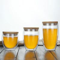 Taza de cristal reutilizable de la taza de cristal de la pared doble al por mayor Taza de cristal de las tazas de café con la tapa de bambú para el té Drinking350ML
