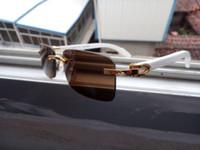 جملة جديدة الجاموس نظارات شمسية النساء الرجال بدون إطار خمر الصيف نمط القطة العين العلامة التجارية مصمم بافالو القرن نظارات شمسية الشعبية
