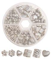 Una caja de 185PCS granos del espaciador de metal de plata Antiqued para la fabricación de joyas