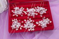 الزفاف مجوهرات الزفاف كليب أغطية الرأس اليدوية لؤلؤة الشعر اكسسوارات الزهور اليدوية لؤلؤة الشعر كعكة شكل الشعر الأبيض بالجملة