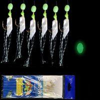 6pcs / bag alta acciaio al carbonio Agganciare vera pelle piuma ami legare di pesca branzino Carp Fishing luminoso String Ganci Pesce vivo della pelle