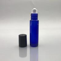 Blu cobalto 10ml 1 / 3oz Vetro Spesso rullo sulla bottiglia di olio essenziale vuota aromaterapia bottiglia di profumo con rotella metallica sfera e nero coperchi