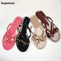 Flip Flops Fashion Donna Rivetti Sandali Donna Bow knot Pantofole piatte Studded Cool Beach Slides Jelly Shoes