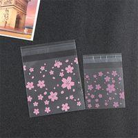 100pcs Schneeflocke transparenten Kunststoff Cellophan selbstklebende biscuit Süßigkeit Imbiß-Lebensmittelbeutel DIY Beutel Geschenkverpackung