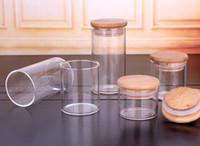 Videz ronde Herb Croquettes de riz bonbons Pot de rangement transparent cylindre résistant à la chaleur en verre borosilicate Airtight Pot de rangement avec couvercle en bambou