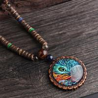 امرأة سترة قلادة الجملة مجوهرات خشبية قلادة الطاووس الريش نمط قلادة طويلة للنساء