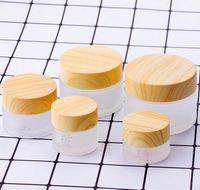 Contenants cosmétiques pots 5g 10g 15g 30g 50g 100g Botte de crème de crème de verre givrée avec couvercle de grain de bois