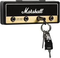 Gancho de chave da guitarra da guitarra da guitarra da montagem do Jack de Marshall licenciada. Inclui 4 chaveiros de plugue de guitarra e 1 kit de montagem de parede. Installatio fácil.