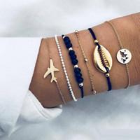 6pcs / lot nuovi braccialetti della conchiglia della Boemia messi per le donne Velivoli dorati Mappa incanto catene di perle di cristallo Braccialetto Gioielli moda femminile Boho