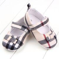 Zapatos de bebé suaves de la primavera Sole algodón niña primeros caminante Moda Zapatos de los bebés de la mariposa del nudo de los zapatos para niños Primera Sole