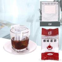 La bolsa 50pcs / lot filtro de goteo de café colgando oído portable café del estilo de los filtros de papel de Ministerio del Interior de viajes Brew café y té Herramientas BH2986 DBC