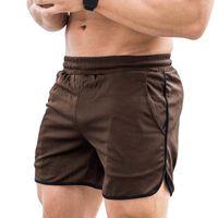 Allenamento Uomini Shorts fitness secchezza rapido Palestra Beach pantaloncini estivi Lounging Sport in esecuzione pantaloni corti con tasche