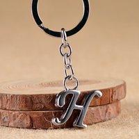 Diseñador de letras A - Z Llavero metal plateado rodio unisex simple llavero del nombre de letra del coche del anillo dominante para el mejor partido llavero diseñador