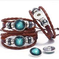 Piel pulseras hechas a mano de la constelación 12 Diseño del zodiaco cuerda de la cera pulseras de cadena Snap Botones brazalete de la vendimia de las mujeres de los hombres amante de la joyería