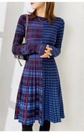 2020 Nuevo invierno frío vestido de viento alto sentimiento francés primer amor naranja tallo hadas falda rica esposa tejer suéter falda