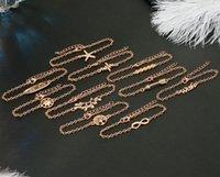 Смешайте 10 стиль 10шт розового золота браслет Оливковая ветвь дерева Лаки Морская звезда Бесконечность знак мира верят браслет 19см + 5см