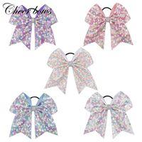 Accessoires pour cheveux Accroyez les arcs pour filles Rainbow Sequin avec titres de queue de cheval en pom-pom gamme