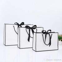 핸들 웨딩 파티 호의 bowknot 종이 선물 가방 LX01480와 크리 에이 티브 디자인 큰 검은 테두리가 흰색 크래프트 종이 가방