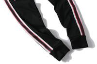 Бесплатная доставка спортивные штаны Мужские Jogger брюки фирменные спортивные брюки спортивные брюки высокая мода 3 цвета боковые полосы дизайнерские пробежки