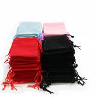 100pcs التي 5x7cm المخملية الحقيبة الرباط كيس / حقيبة مجوهرات عيد الميلاد / هدية الزفاف حقائب أسود أحمر وردي أزرق 4 اللون بالجملة